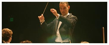 Chapman's Music Conductor Moonlights a World Away